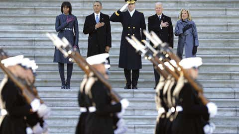 President Barack Obama, first lady Michele Obama, left, Army Major General Michael Linnington, center, and Vice President Joe Biden and his wife Jill Biden, place their hands over their hearts as they review the troops following his ceremonial swearing-in during the 57th Presidential Inauguration at the U.S. Capitol in Washington. (AP Photo/Cliff Owen)