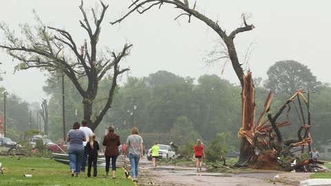 Residents survey damage near an elementary school, caused by severe weather, Monday, May 11, 2015, in Van, Texas. (AP Photo/Todd Yates)