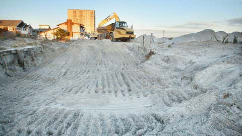 A construction crew works on replacing the dunes at 35th Ave in Longport, N.J. Thursday Nov 8, 2012 after Winter Storm Athena and Hurricane Sandy hit the region. (AP Photo/The Press of Atlantic City, Edward Lea)
