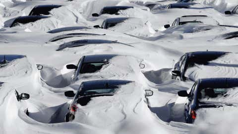 Snow begins to melt on cars parked at a dealership after a winter storm in Hartford, Conn., Sunday, Feb. 10, 2013. (AP Photo/Jessica Hill)