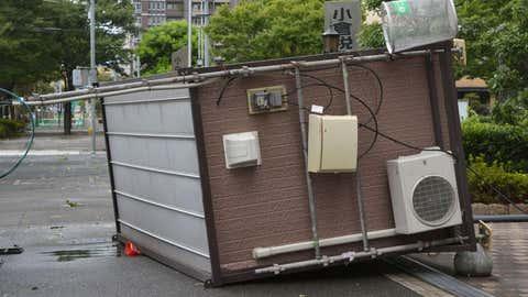 A prefabricated hut topples into a street after Typhoon Goni hit Kitakyushu, Fukuoka prefecture, southwestern Japan, Tuesday, Aug. 25, 2015. (AP Photo/Daiki Maeda/Kyodo News via AP)