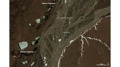 Aerial views of Dalton Highway in its normal state, taken on June 14, 2013 by the Operation Land Imager on Landsat 8. (Photo Credit: NASA Earth Observatory)