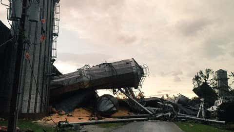 Damage in Cameron, Illinois, after a tornado slammed the town during severe thunderstorms on Thursday, July 16, 2015. (Photo Credit: Twitter/Kholby Martin)