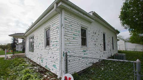 The exterior siding of home is damaged from hail in Blair, Neb., Wednesday, June 4, 2014, following a severe storm that passed through the region the previous evening. (AP Photo/Nati Harnik)