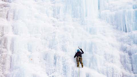 A climber leads the way up the ice above Lake Willoughby in Vermont's Northeast Kingdom. The lead climber protects the party by placing ice screws in the ice. Screws generally range from 4 to 9 inches and catch falls as well as secure belays. (Ian MacLellan)