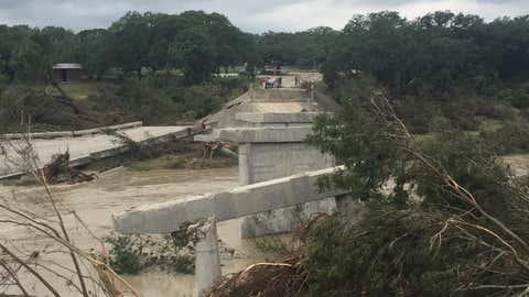 Damage to the Fischer Store Road bridge seen in Wimberley, Texas, on Sunday, May 24, 2015. (Photo Credit: Twitter/Bridget Spencer)