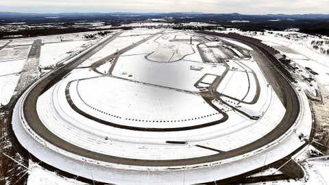 Snow covers the grounds at Talladega Superspeedway Wednesday, Jan. 29, 2014, in Talladega, Ala. (AP Photo/David Tulis)