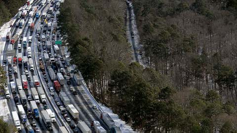 This aerial photo, traffic is snarled along the I-285 perimeter north of the metro area after a winter snow storm Wednesday, Jan. 29, 2014, in Atlanta. (AP Photo/David Tulis)