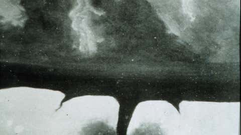"""One of the oldest known photographs of a tornado. It is probable this image has been """"doctored"""" from the original. At this time, the oldest known photograph of a tornado was taken on April 26, 1884 at Garnett, Kansas."""