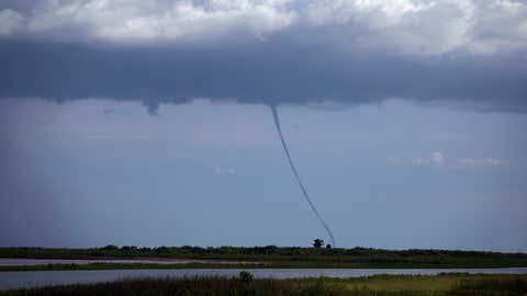 A waterspout touches down over Lake Okeechobee in Florida on July 9, 2007. (Joe Raedle/Getty Images)