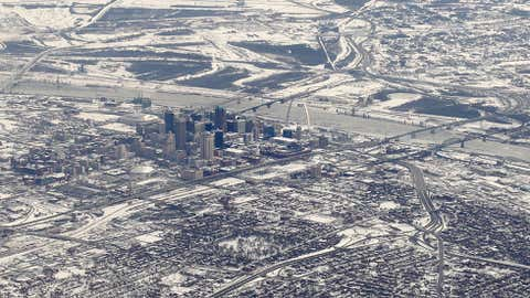 Snow and ice are seen covering up Mississippi River and downtown St. Louis Wednesday, Jan. 8, 2014. (AP Photo/Kiichiro Sato)