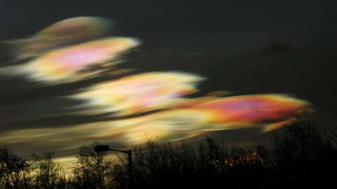 In late January/early February 2016, unusually cold Arctic stratospheric air reached down as far as the UK. This triggered sightings of rare and beautiful Polar Stratospheric (Nacreous) Clouds. I had to go down to Alloa for a course and took an old compact digital camera with me, just in case any displays were visible from that part of the country. PSCs have a sinister side, though: chemical reactions on the surface of the clouds actually destroy ozone. The image was taken with a Canon PowerShot G9. Exposure: 1/2000 Sec @ f/8 and ISO-400.