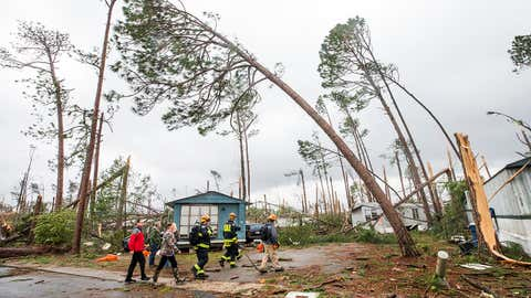 Georgia Search and Rescue team members enter the Big Pine Estates in Albany, Ga. Monday, Jan. 23, 2017, to look for survivors who may still be trapped as well as victims of the tornadoes that hit the Albany area the day before. (Colin Hackley / weather.com)