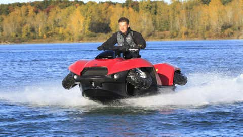 In this Oct. 12 photo, the Quadski, a one-person motor boat that also drives on land, is tested in in Oxford, Mich. (AP Photo/Carlos Osorio)