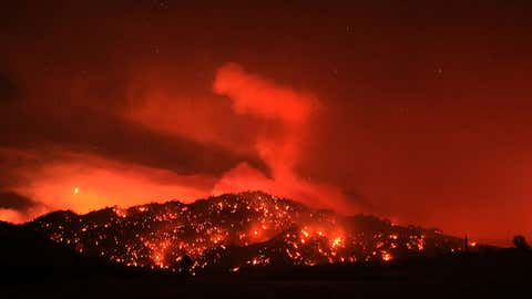 In this Tuesday, Aug. 2, 2016 photo, the Cold fire burns at night by the Solano and Napa County line near Lake Berryessa, California. (Kent Porter/The Press Democrat via AP)