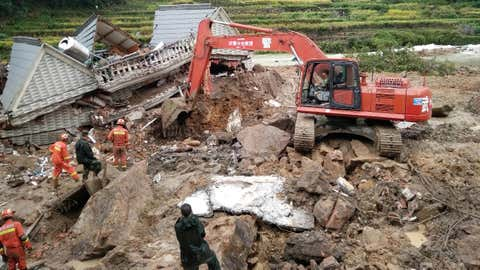 Chinese rescuers search at the site of the landslide in Sucun village, Beijie town, Suichang county, Lishui city, east China's Zhejiang province, Sept. 29, 2016. (Imaginechina via AP Images)