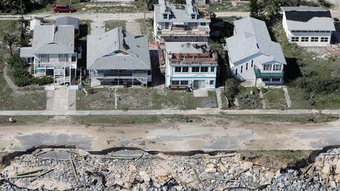 In this aerial photo, portions of SR A1A are washed out from Hurricane Matthew, Saturday, Oct. 8, 2016, in Flagler Beach, Fla.  The damage from Matthew caused  beach erosion, washed out some roads and knocked out power for more than 1 million customers in several coastal counties. (AP Photo/Chris O'Meara)