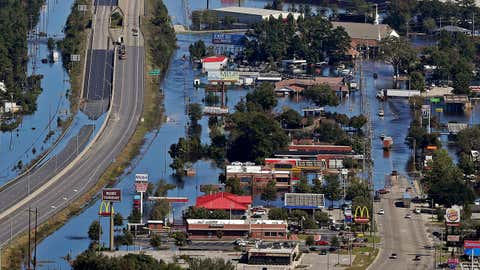 Floodwaters from Hurricane Matthew covers parts of Interstate 95 and homes and businesses in Lumberton, N.C., Wednesday, Oct. 12, 2016. People were ordered to evacuate, and officials warned that some communities could be cut off by washed out roads or bridge closures. (AP Photo/Chuck Burton)