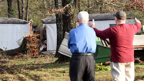 Patrick Davenport, left, and neighbor J.P. Kelley look over the scene of Monday's deadly severe weather that claimed the lives of multiple people in Rehobeth, Alabama, Tuesday, Jan. 3, 2017. (Danny Tindell/Dothan Eagle via AP)