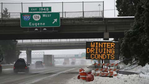 Traffic moves slowly along Interstate 5 through Eugene and Springfield, Ore. area as a winter storm moves through the Willamette Valley Sunday Jan. 8, 2017. Snow and sleet are making for treacherous roads in Oregon, with the state police warning that they can't keep up with all the crashes. (Chris Pietsch/The Register-Guard via AP)