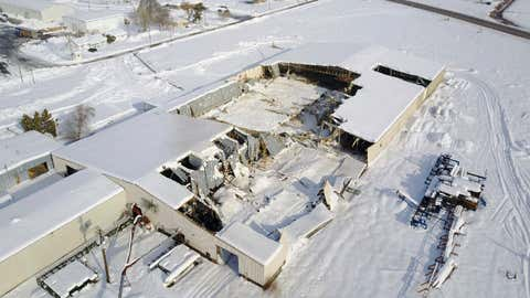 This Jan. 20, 2017 aerial image provided by Rapid Aerial LLC shows a Partners Produce facility in Payette, Idaho, that collapsed under the weight of snow. (Jason Brainerd/Rapid Aerial LLC via AP)