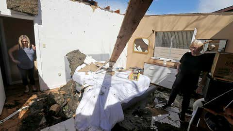 Mikela Kinnison, left, and her mother Ilona show the damage to the bedroom at Kinnison's home in San Antonio after tornadoes moved through the area late Sunday night. (Edward A. Ornelas/The San Antonio Express-News via AP)