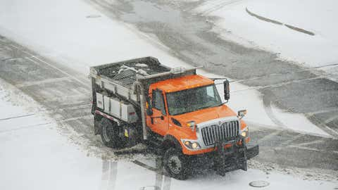 A St. Joseph City snowplow clears a section of Broad Street in St. Joseph, Mich., Wednesday, Feb. 24, 2016. (Don Campbell/The Herald-Palladium via AP)