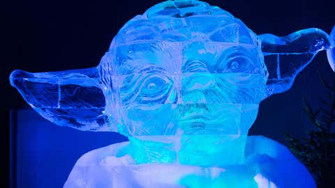 An ice-sculpture in the form of Star Wars character Yoda is displayed during the Star Wars Ice sculpture festival in Liege, Belgium on Dec. 16, 2015. (Rex Features via AP Images)