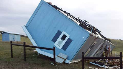 This photo provided by CalFire San Luis Obispo shows a mobile home that was overturned by strong winds in Paso Robles, Calif., Wednesday, Jan. 6, 2016. The winds are associated the first of a series of El Nino storms that are lined up across the Pacific, dumping heavy rain and snow throughout California. (CalFire San Luis Obispo via AP)