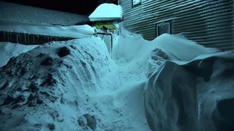 There is a path cleared to a door of this home in Altmar, New York, clobbered by Winter Storm Argos on November 21, 2016. (Shane Muckey/Facebook)