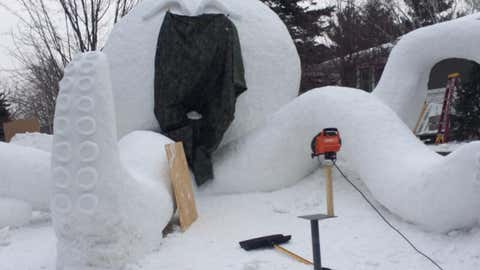 The 18-foot-high snow sculpture of an octopus sits in the Bartz brother's front yard in New Brighton, Minnesota.