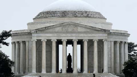 Workers clear snow from the Jefferson Memorial on March 17, 2014 in Washington, DC. (Win McNamee/Getty Images)
