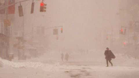 A New Yorker makes her way down Seventh Avenue in Manhattan January 8, 1996 during a blizzard that shut down airports and caused the mayor to declare a state of emergency. Image credit: ROBERT MILLER/AFP/Getty Images