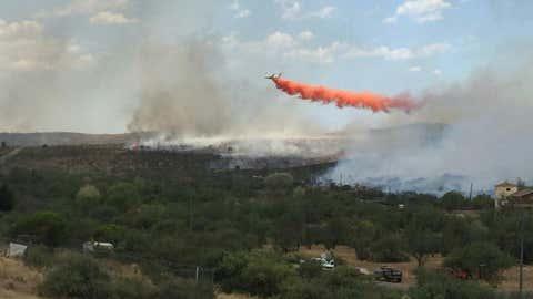 A tanker plane makes a drop on the Bug Creek Fire in Arizona. (AZSF)