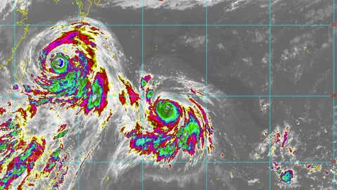 Infrared satellite image from Himawari-8 satellite of Typhoon Chan-hom (left) and Super Typhoon Nangka (left-center) in the western Pacific Ocean on July 9, 2015 at 12 p.m. U.S. EDT. (JMA/CIRA/RAMMB)