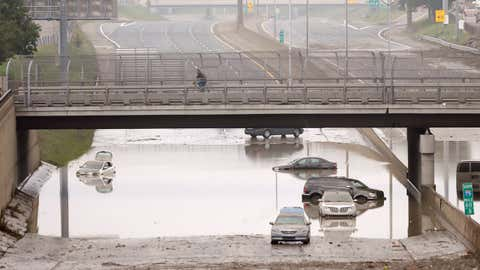 Cars are stranded along a flooded stretch of Interstate 75 in Hazel Park, Michigan, Tuesday, Aug. 12, 2014. (AP Photo/Carlos Osorio)