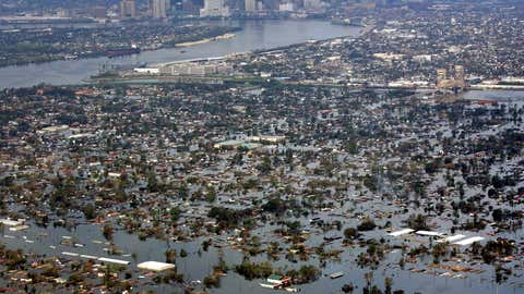 In this Aug. 30, 2005 file photo, floodwaters from Hurricane Katrina cover the Lower Ninth Ward, foreground, and other parts of New Orleans, a day after the storm passed through the city. (AP/David J. Phillip, File)