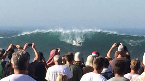Crowds gather at the Wedge, a popular place for surfers in Newport Beach, California, on Wednesday. (Jeff Goertzen for weather.com)