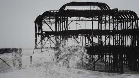 A large section of Brighton's dilapidated West Pier has been washed away in the latest storm on Feb. 5, 2014, in Brighton, United Kingdom. (Mike Hewitt/Getty Images)
