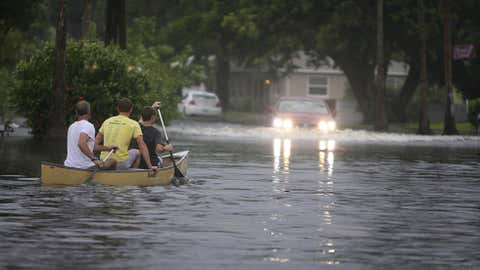 Canoe-goers navigate flooded streets as flooding continues to worsen and Tropical Storm Debby pounds the Tampa Bay, Florida, area Sunday, June 24, 2012. (AP Photo/Tampa Bay Tribune, Chris Zuppa)