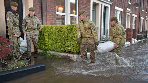 Members of the Army help with the rescue effort after Storm Desmond caused flooding on December 6, 2015 in Carlisle, England. Storm Desmond has brought severe disruption to areas of northern England as dozens of flood warnings remain in place. (Jeff J Mitchell/Getty Images)