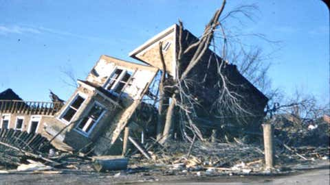 Remnants of a destroyed house lean against a tree after a tornado struck Gorham and Murphysboro, Ill., on Dec. 18, 1957. (Photo used with permission of the Jackson County Historical Society, Murphysboro, Ill.)