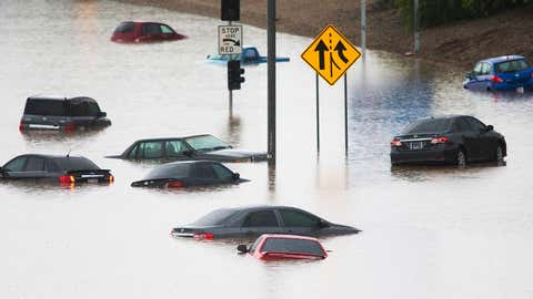 Cars are underwater at 43rd Ave. and I-10 in the westbound lanes in Phoenix, Monday, Sept. 8, 2014, after record-setting rainfall caused massive flooding throughout the Valley. (AP Photo/The Arizona Republic, Tom Tingle)