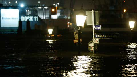 Roadsigns peak out of the water on the flooded 'Fischmarkt' (fish market) on December 6, 2013 in Hamburg, Germany. (Philipp Guelland/Getty Images)