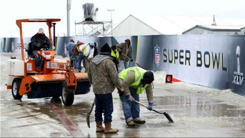 Workers clear ice outside of Cowboys Stadium Feb. 3, 2011. (Getty Images)