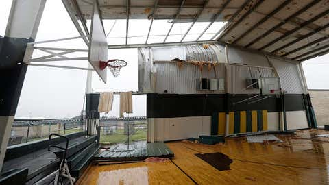 The basketball facility for Rockport High School is exposed to the outside after it lost part of its roof and walls from Hurricane Harvey, Saturday, Aug. 26, 2017, in Rockport, Texas. (AP Photo/Eric Gay)