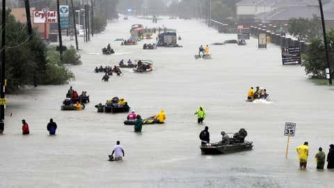 Rescue boats fill a flooded street as flood victims are evacuated as floodwaters from Tropical Storm Harvey rise in Houston on Aug. 28, 2017. (AP Photo/David J. Phillip)