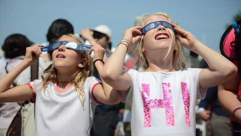 Observers watch the solar eclipse at the Canadian National Exhibition in Toronto on Monday, August 21, 2017. THE CANADIAN PRESS/Jon Blacker