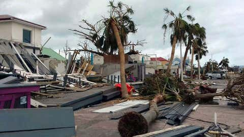 Damaged buildings and fallen trees litter downtown Marigot, on the island of St. Martin, after the passing of Hurricane Irma on Sept. 9, 2017. On the Dutch side of St. Martin, an island divided between French and Dutch control, an estimated 70 per cent of the homes were destroyed by Irma, according to the Dutch government. THE ASSOCIATED PRESS/Amandine Ascensio