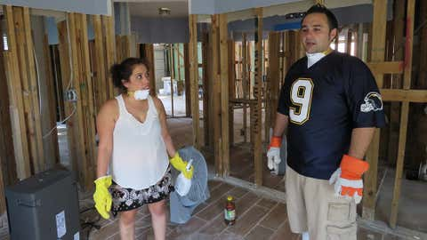 In this Sept. 22, 2017 photo, Marcela and Eli Magana discuss cleaning up their suburban Houston home, which was flooded during Harvey's torrential rainfall. The couple's home in Fort Bend County was flooded when the levels of a nearby reservoir swelled beyond capacity during Harvey and spilled over into neighbouring subdivisions. The Maganas and other flooded homeowners in subdivisions near the reservoir are questioning whether officials in Fort Bend County did enough to warn them the reservoir could overflow during a heavy storm event and inundate their homes. (AP Photo/Juan Lozano)